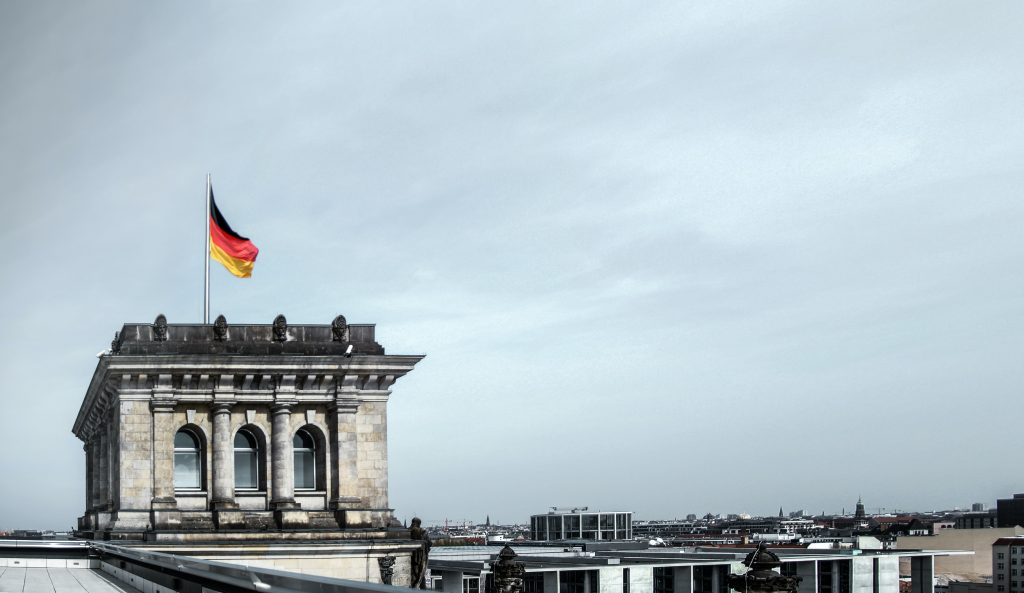 The German flag flying over the Bundestag building