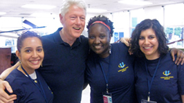 From left: Michelle Munoz, Myeashea Alexander, and Kristin Molloy with President Clinton