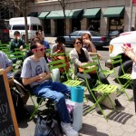 A New School student teaches a popup sustainability class at the Union Square Green Market.