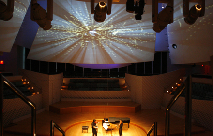 Musicians at New World Symphony in Miami perform underneath a digital projection designed by students from Parsons The New School for Design. Photo courtesy of the New World Symphony.