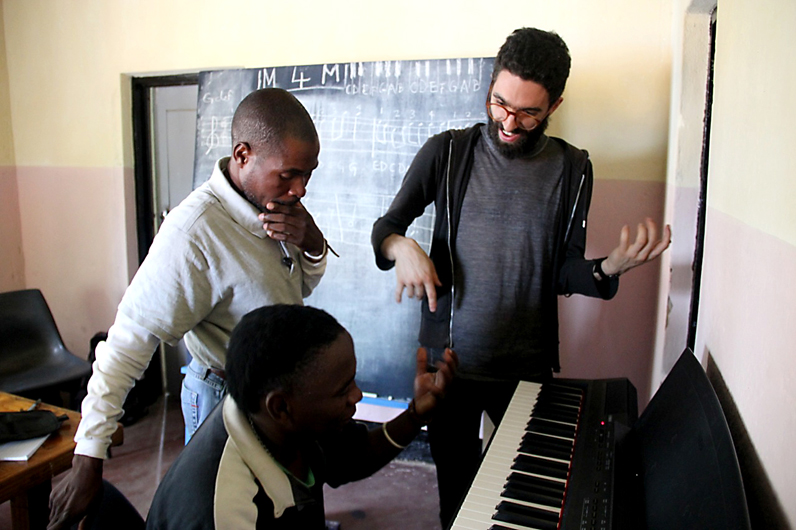 New School Jazz student Derek Baron leads a music class while volunteering with the Malawi-based organization Komai. Photo courtesy of Nicolas Galvan.