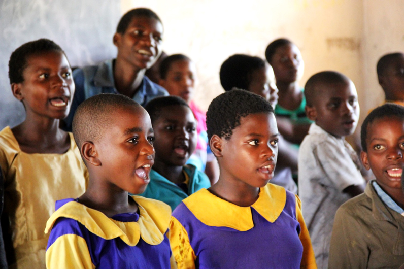 Students perform local songs during an after-school program with the organization Komai in Malawi. Photo courtesy of Nicolas Galvan.