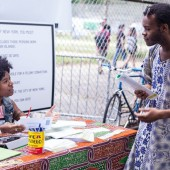 Milano Urban Policy alum Claudie Mabry helps register voters at Progressive Pupil's Activism Row. Photo by Richard Louissaint.