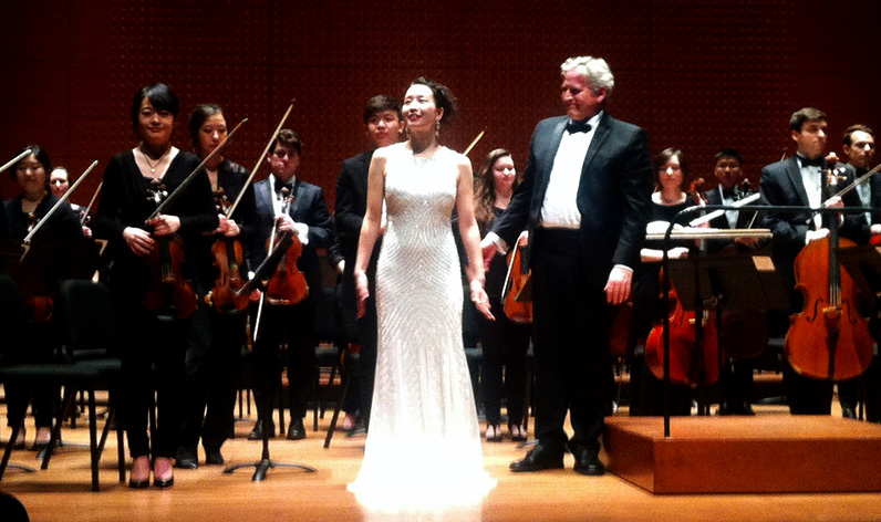Soprano Mizuho Takeshita and conductor David Hayes with the Mannes Orchestra at its Spring 2015 Concert at Lincoln Center's Alice Tully Hall.