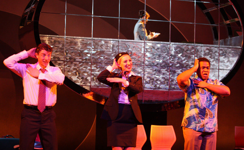 Sean Sullivan as the Steward, Maya Yahav Gour as the Stewardess and Terrence Chin-Loy as Bill star in Mannes Opera and Parsons School of Design's co-production of Jonathan Dove's <em></noscript>Flight</em>.