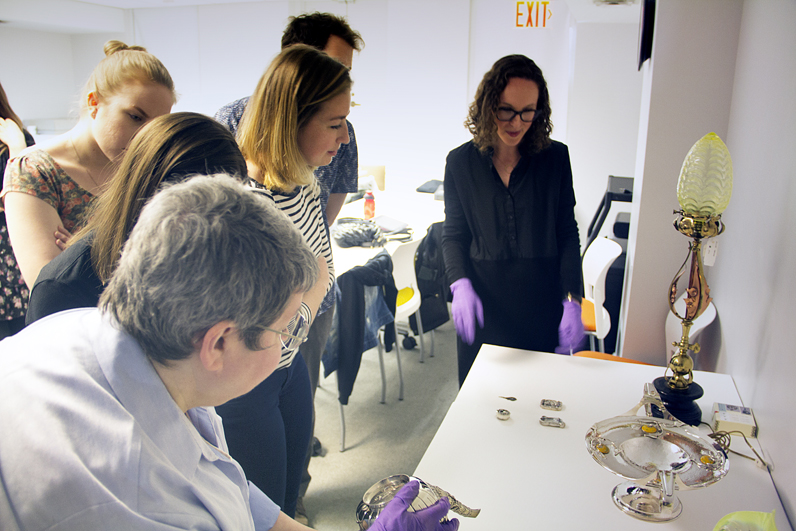 Students in the History of Design and Curatorial Studies program examine historical objects at the Cooper Hewitt, Smithsonian Design Museum.