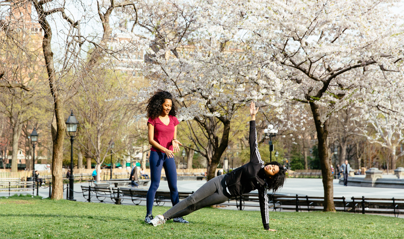 Students practice yoga in Washington Square Park in Greenwich Village.