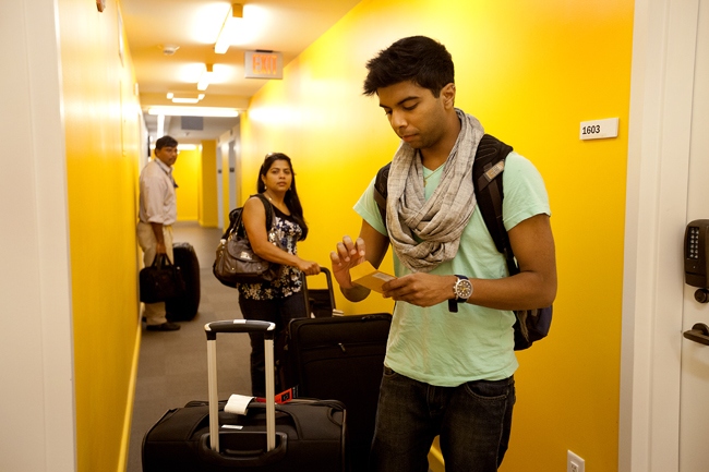 Students move in to the University Center Dorms (Kerrey Hall) on 8/16/13