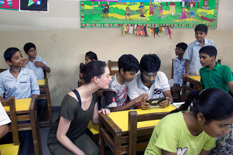 Kate Wallace introduces students in India to BeyondABC.
