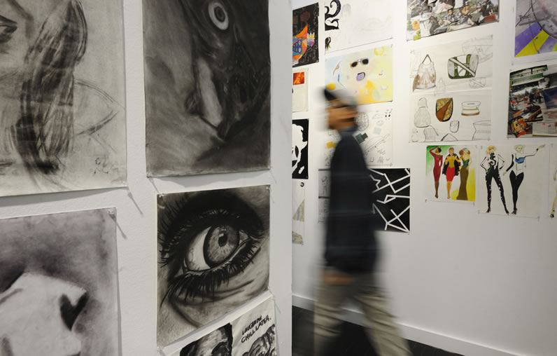 Student artwork adorns the walls at The New School's Pre-College Festival.