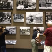 Patrons at the Missouri History Museum in St. Louis examine photographs in the Capturing the City exhibit, which runs from August 2016 through January 2017.