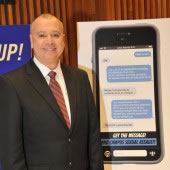 Freddie Dessau with his poster design, which took 2nd place in the NYPD poster contest to encourage victims of sexual assault to report the crimes.