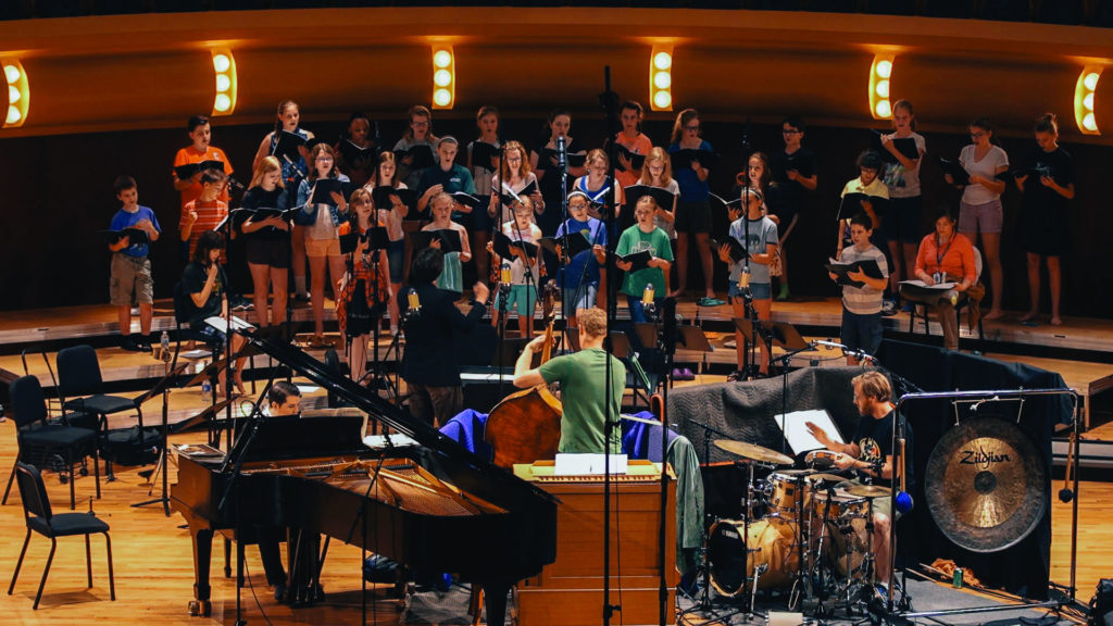 J.J. Wright conducts a recording session of O Emmanuel