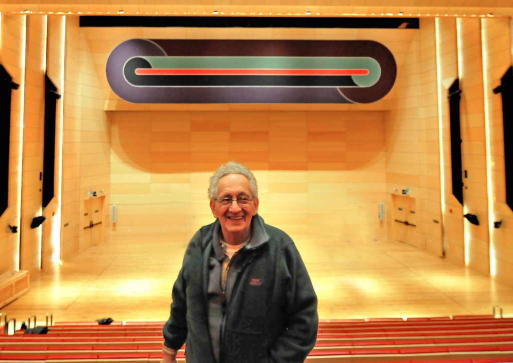 Frank Stella and the installation of his work, Deauville, at the University Center's Tishman Auditorium. (Photo/Eric Stark)