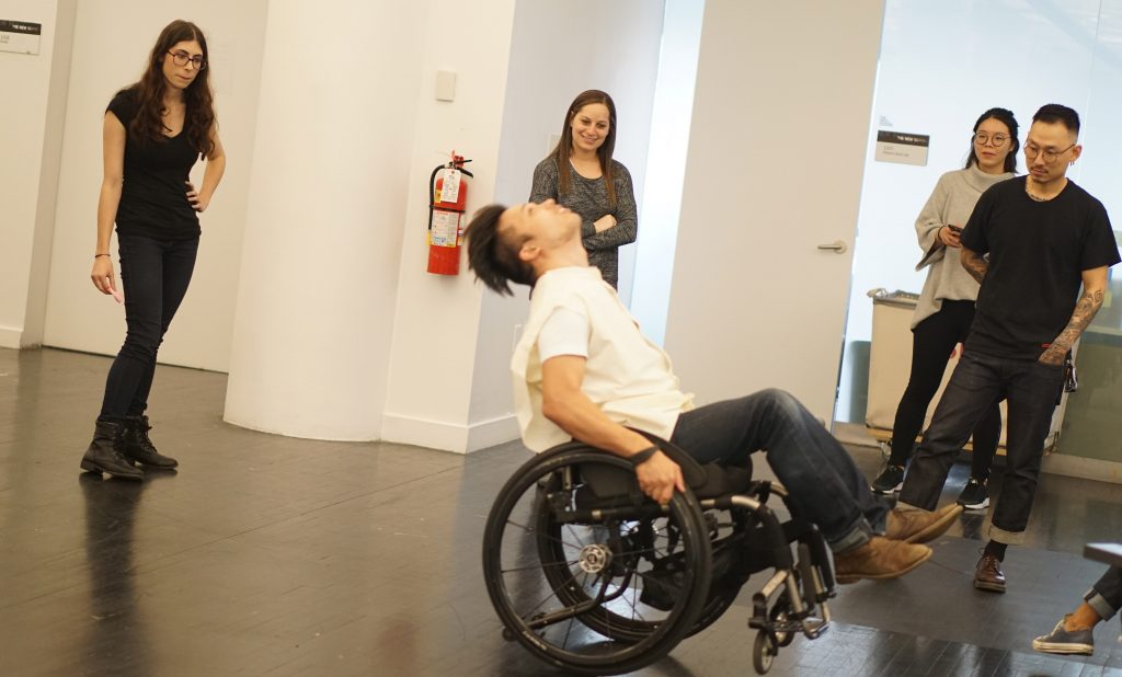 The OSL team of, from L-R, Angela Delise, Elizabeth Bodzy, Chuyi Sun, and Jonathan Lee watch as their client, Peter Trojic, moves around in his wheelchair.