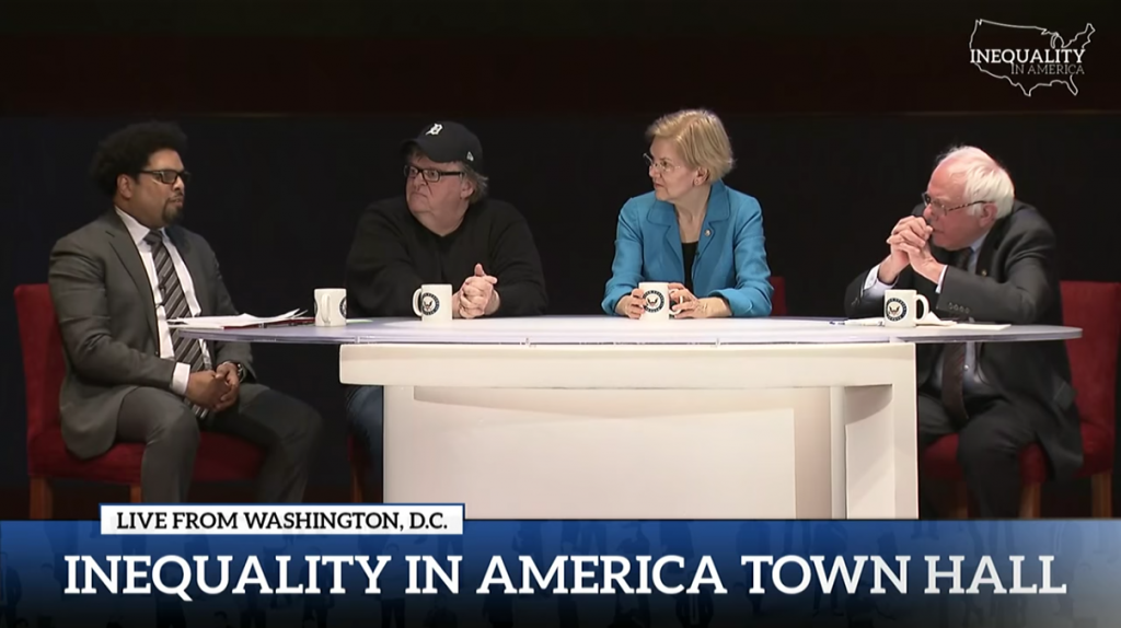 Darrick Hamilton, professor of economics and urban policy at the Milano School and The New School for Social Research, speaks during Inequality in America: A National Town Hall with filmmaker/activist Michael Moore, Sen. Elizabeth Warren, and Sen. Bernie Sanders.