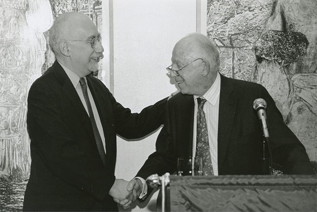 Late New School University Trustee Henry Arnhold shakes hands with Graduate Faculty Dean Ira Katznelson at the President's Council Dinner at The New School in 2000. (Photo / Bjorg Magnea)