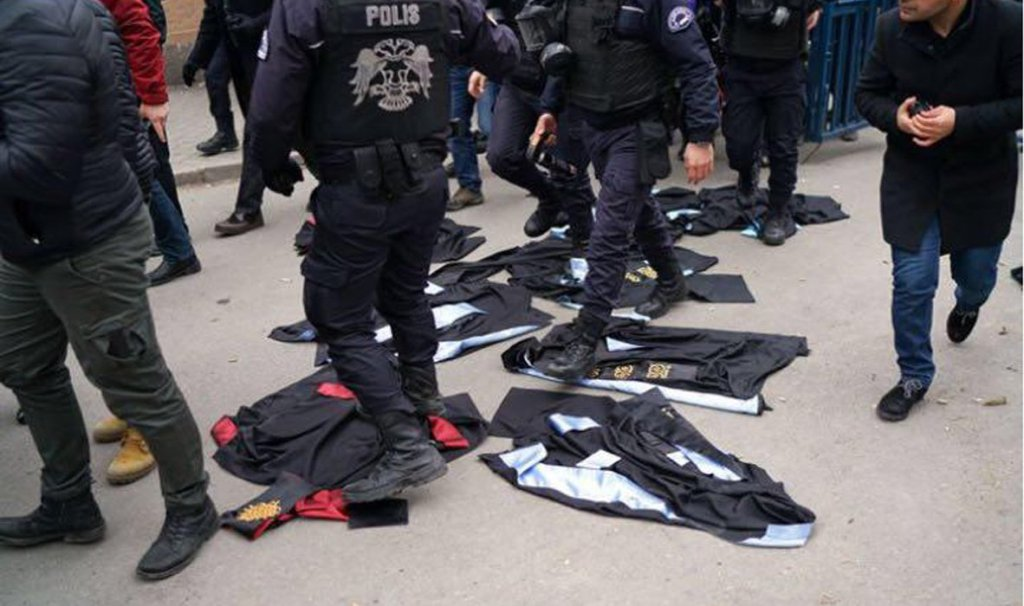 In Ankara, police trample academic regalia laid down in protest against the dismissal of academics from universities (Photo/Umit Bektas, Reuters).
