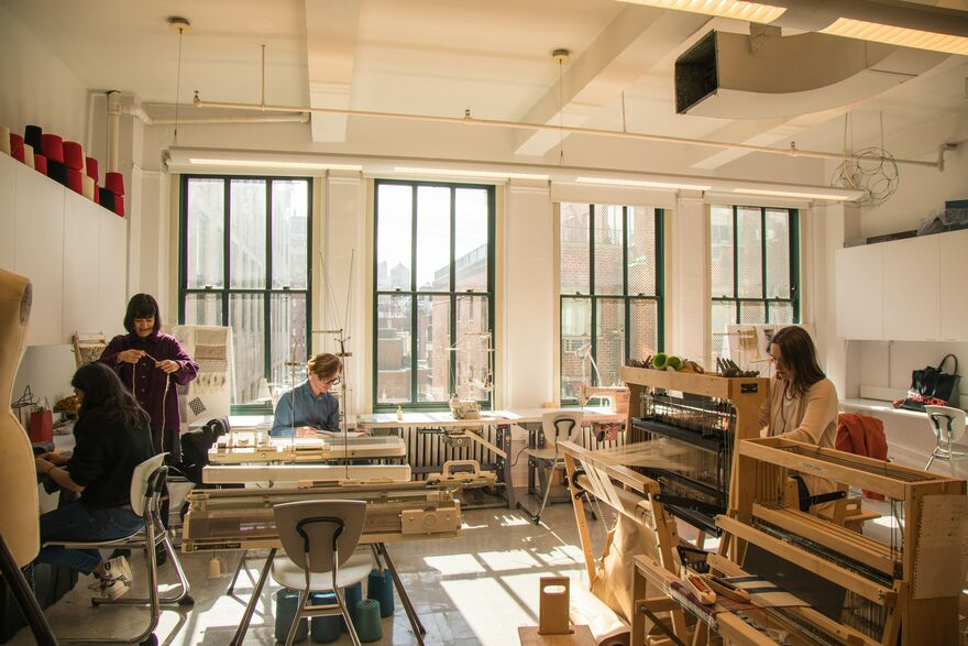 Students from the new MFA Textiles program working in a studio