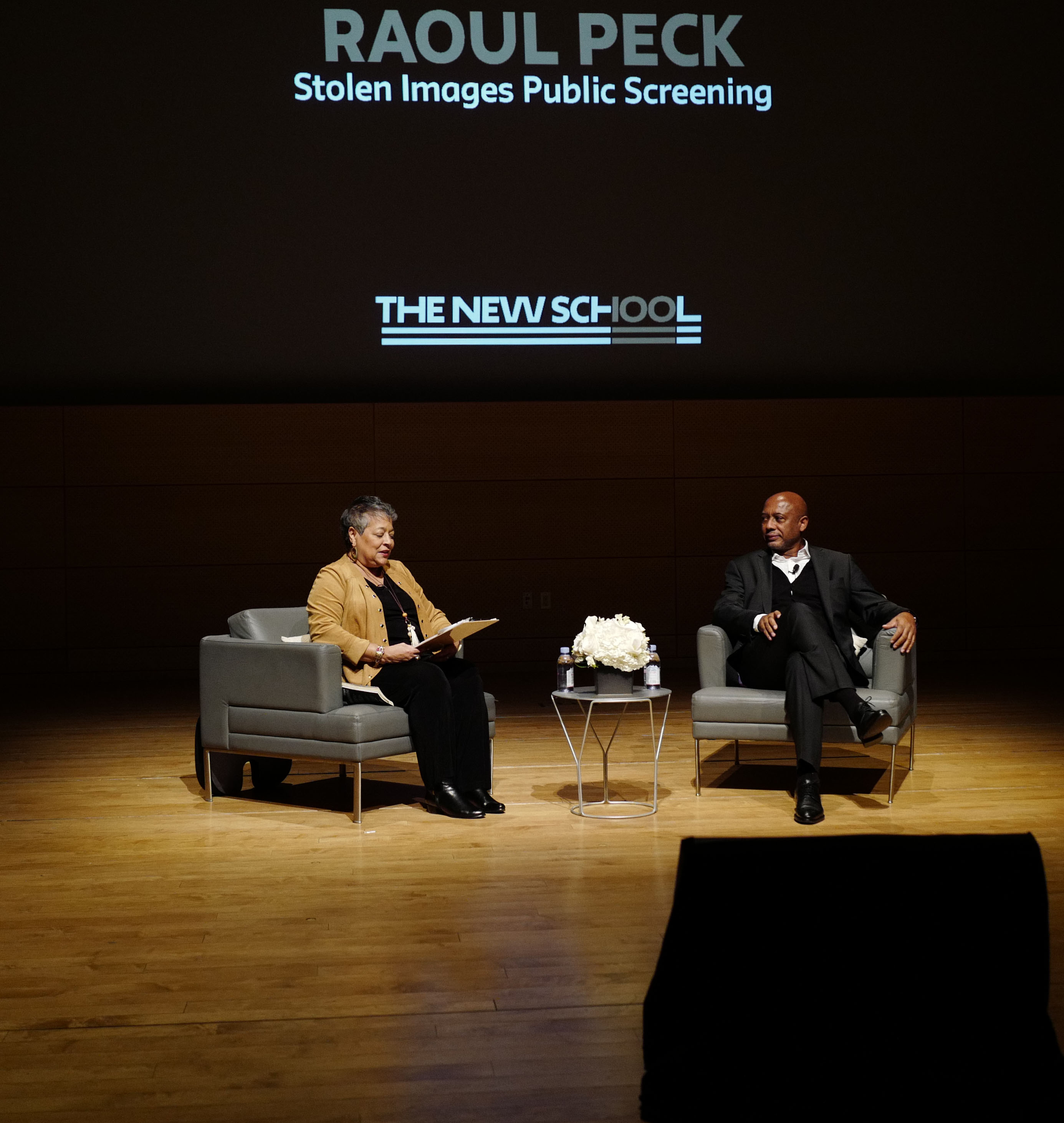 Director Raoul Peck being interviewed by Professor Michelle Materre