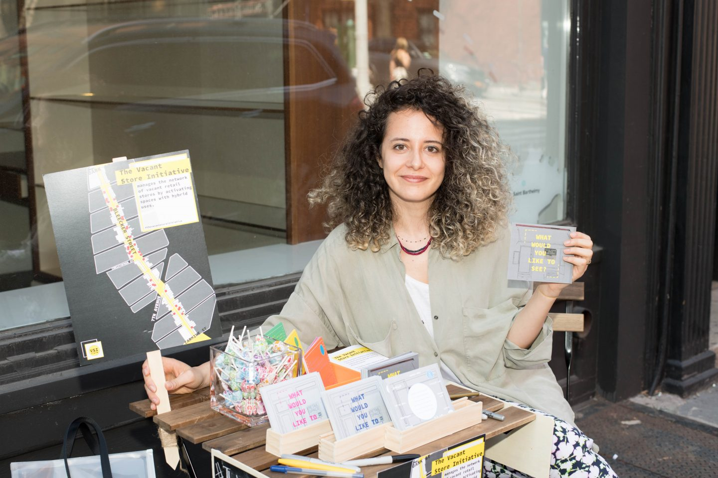 Irem Yildiz on Bleecker Street as part of her Vacant Store Initiative.  Photograph by Erica Freudenstein Photography.