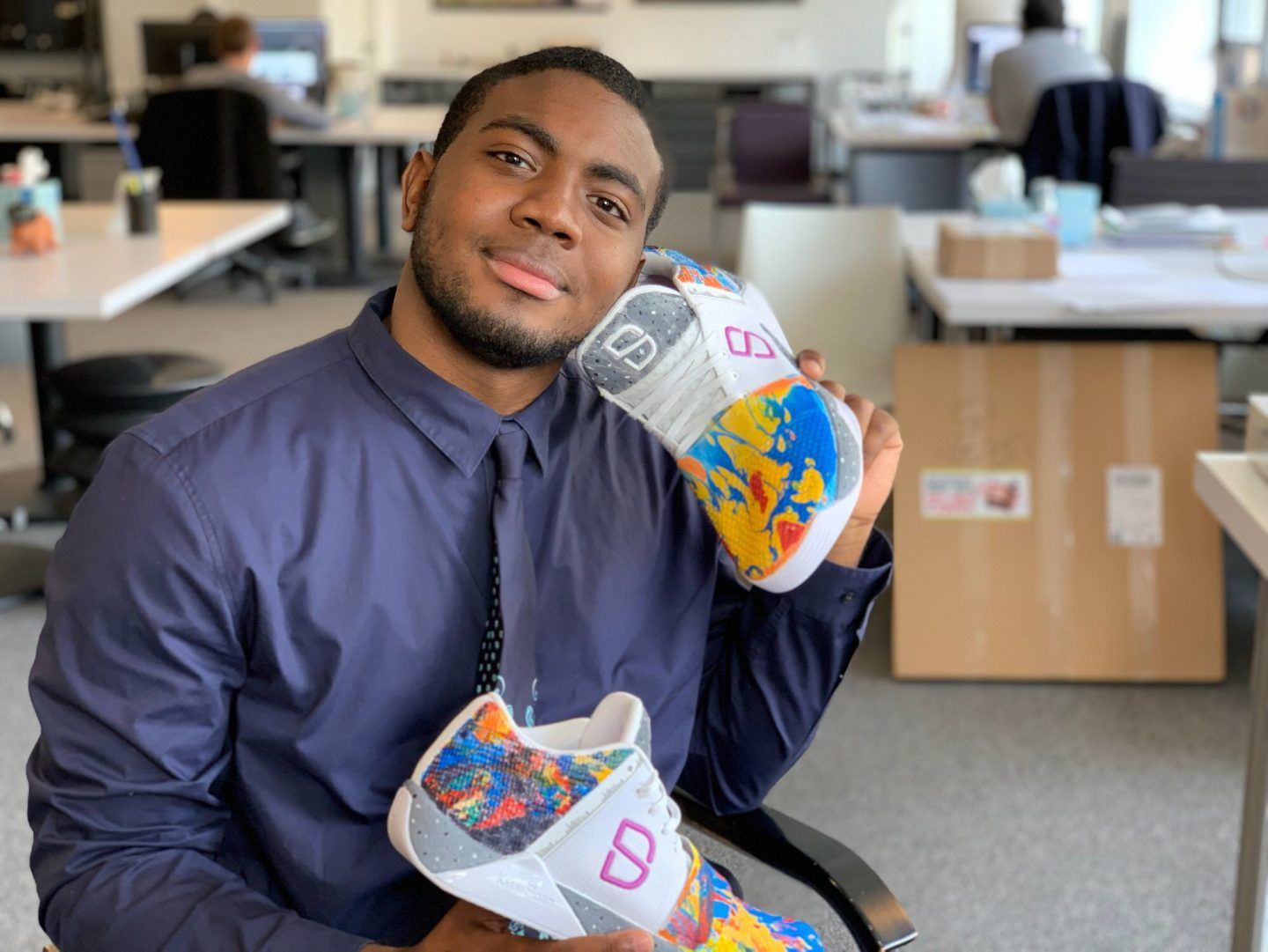 Jahkill Rashad displaying the sneaker he designed for Brooklyn Nets star, Spencer Dinwiddie.