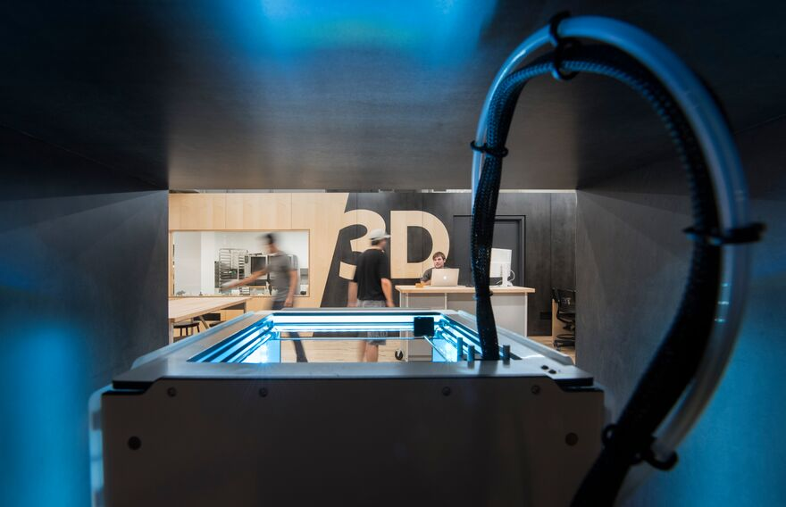 A view of a 3D printer in the Making Center at Parsons