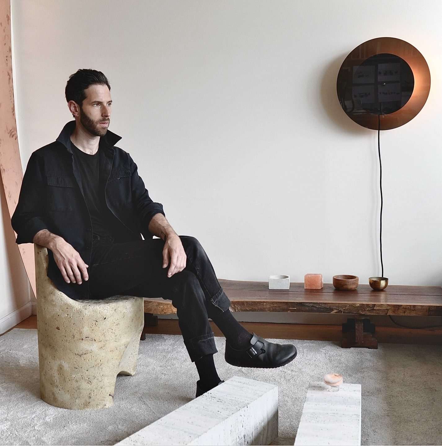 The designer's work explores ideas of time, balance, and sustainability