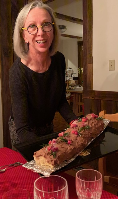 Cathy Kaufman holding a bûche de noel she baked last year
